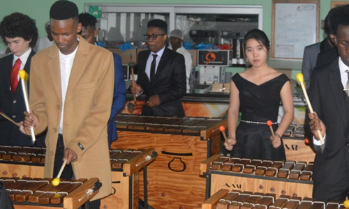 The Marimba group entertaining guests inside the school dining hall
